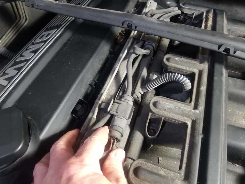 Remove the oxygen sensor wires from fuel rail