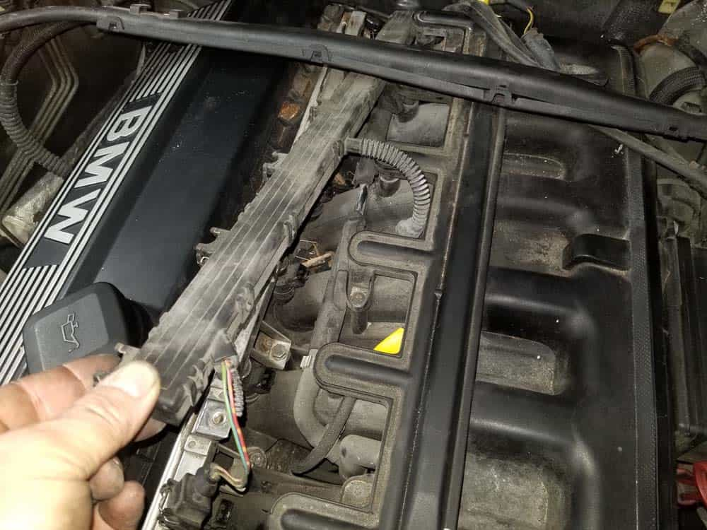 bmw e46 fuel injector replacement - Pull the wiring harness free of the fuel injectors