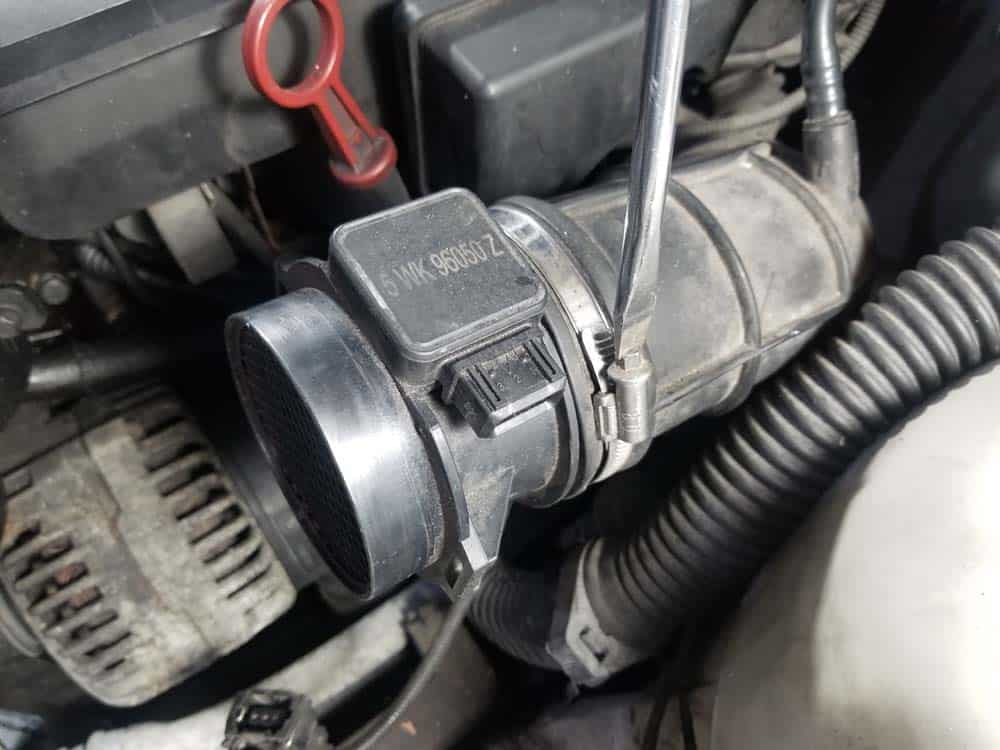 bmw m52 intake manifold removal - Loosen the hose clamp on the mass air flow sensor.