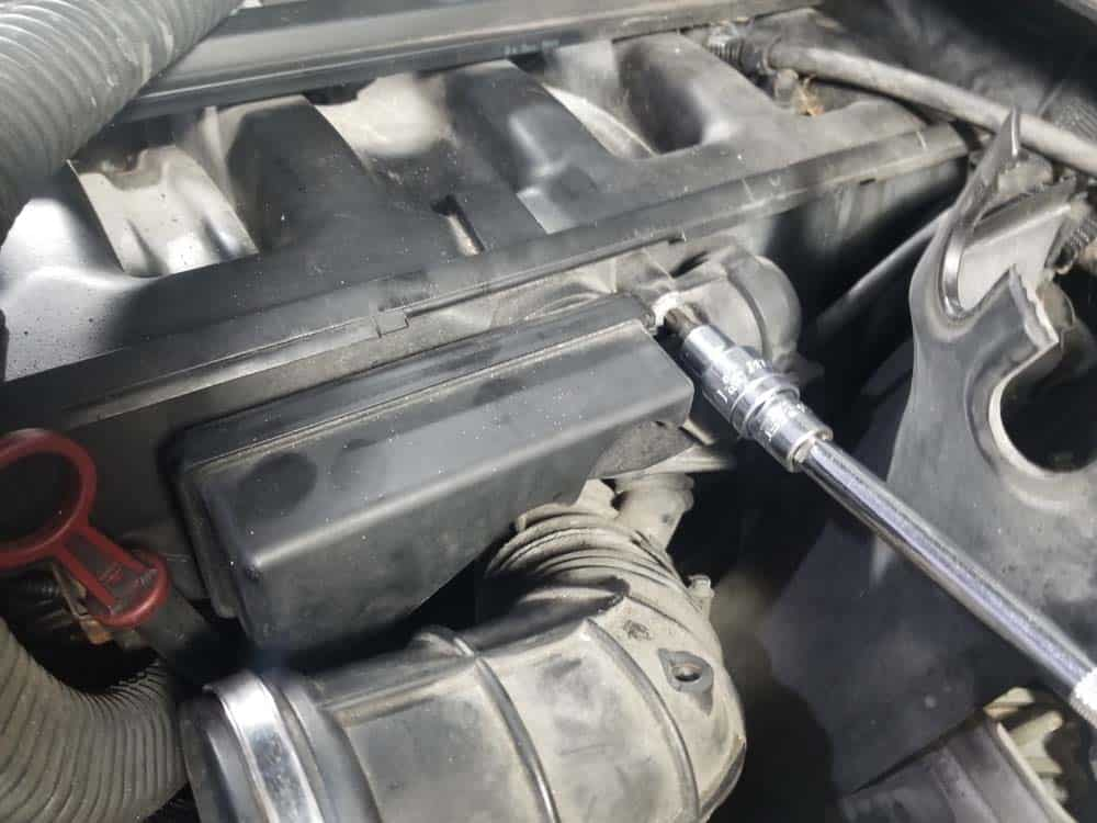 Remove the two T40 bolts anchoring the DISA valve to the Intake manifold