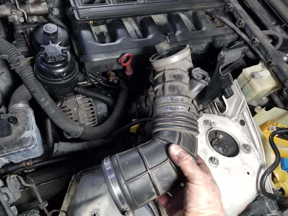 Remove the intake boot from the vehicle