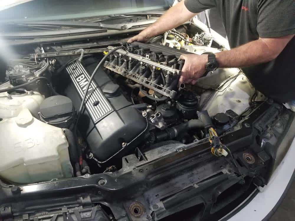 bmw m52 intake manifold removal - Pull the intake manifold free of the engine compartment