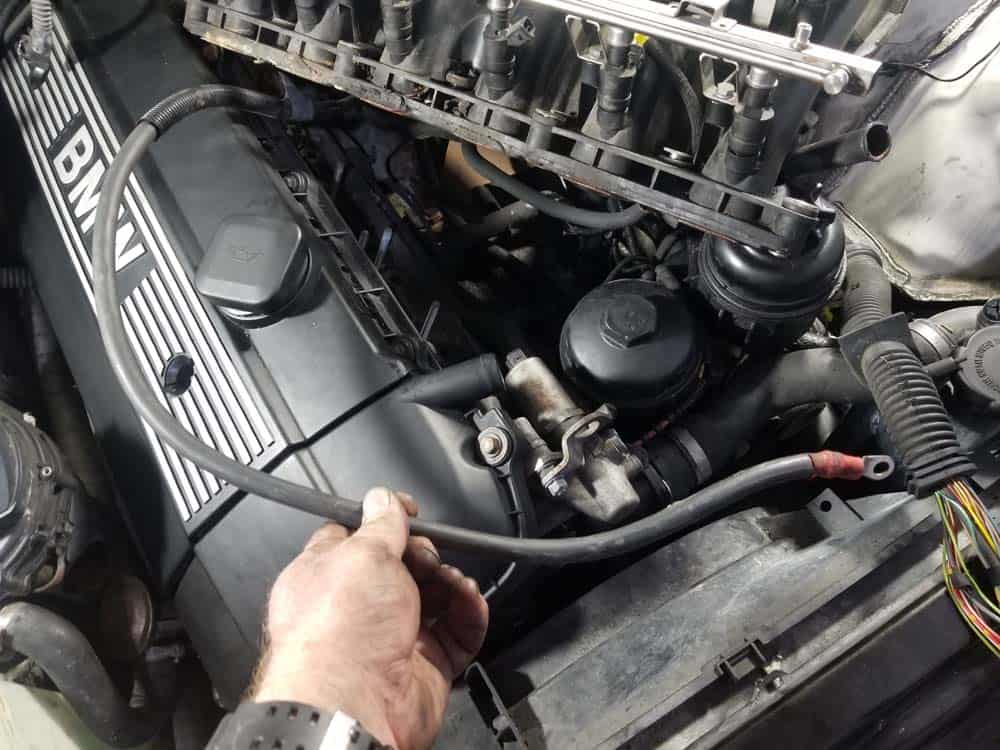 Positive battery cable free of the intake manifold