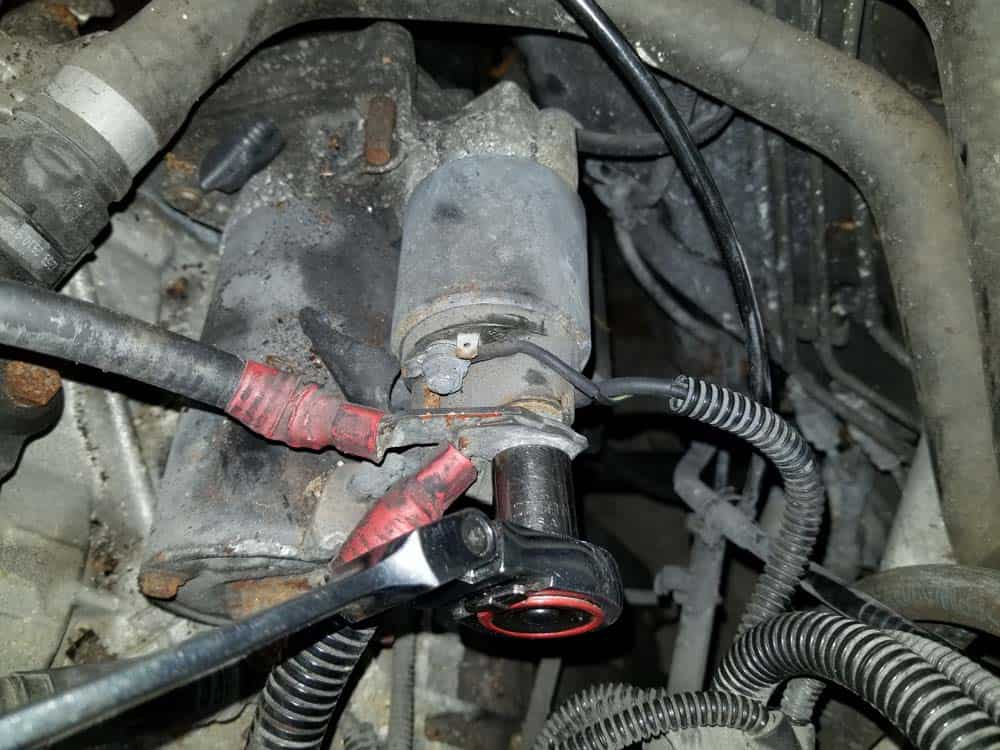 Remove the positive battery and alternator cable from the starter solenoid