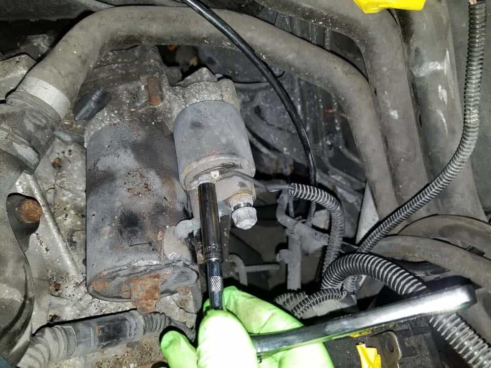 bmw e46 starter replacement - Remove the top wiring harness lead from the starter solenoid