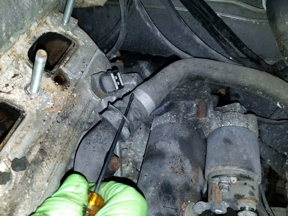 bmw e46 starter replacement - Disconnect the engine coolant line.