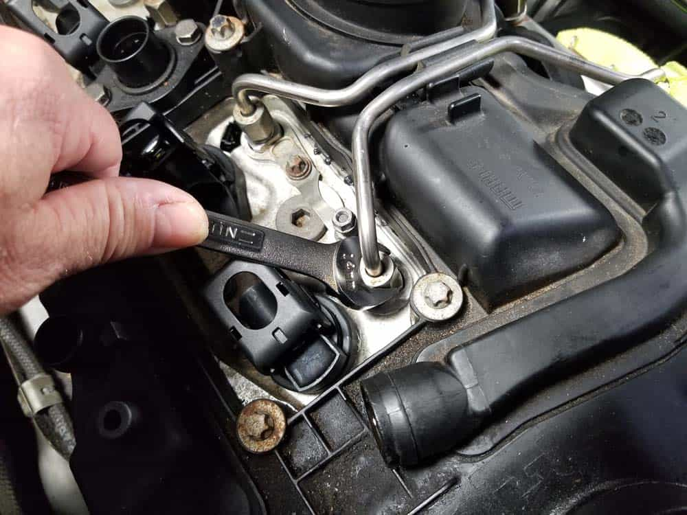 Remove the fuel lines from the top of the valve cover
