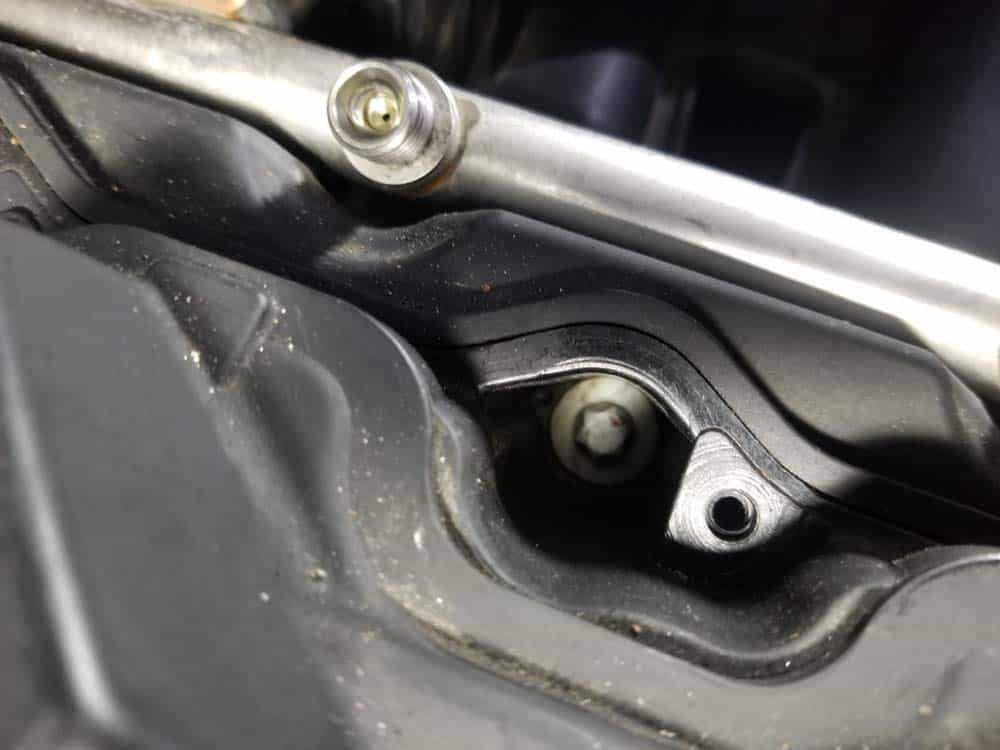 bmw n55 valve cover gasket replacement - There is a valve cover mounting bolt hidden behind the absober