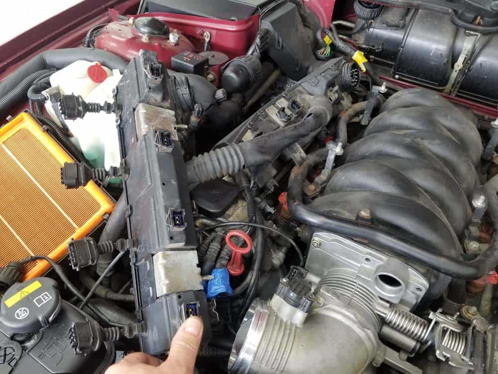 bmw m60 pcv valve replacement - Fold the left wiring harness over and out of the work area.