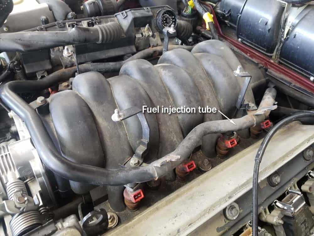 bmw m60 pcv valve replacement - Identify the fuel injection tube on the top of the intake manifold.
