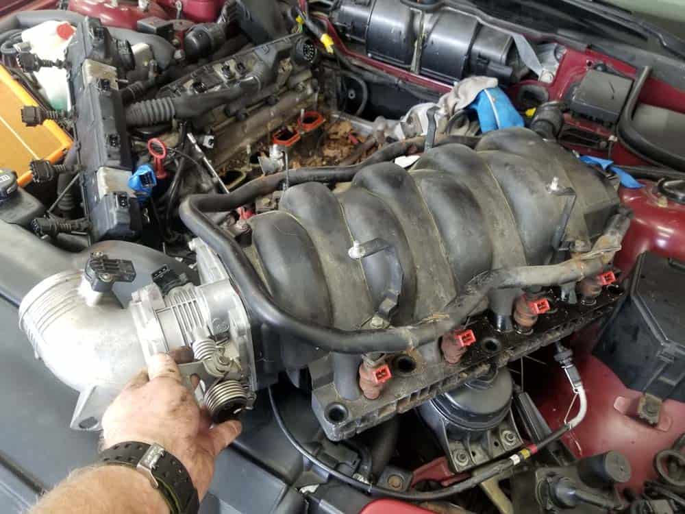 bmw m60 pcv valve replacement - Remove the intake manifold from the vehicle.