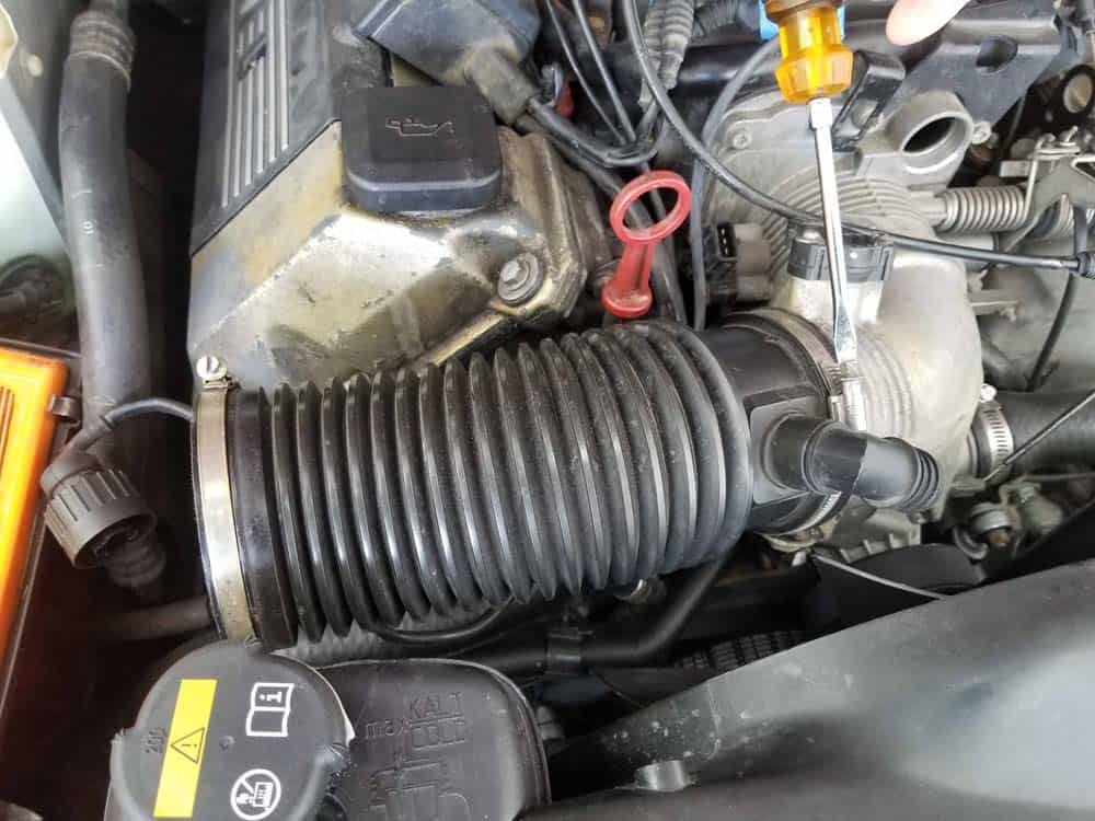 bmw m60 pcv valve replacement - Loosen the intake boot clamp