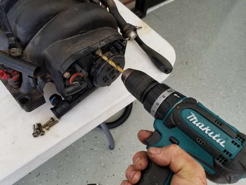"""Use a 1/4"""" drill bit to snap off the heads of stripped mounting bolts"""