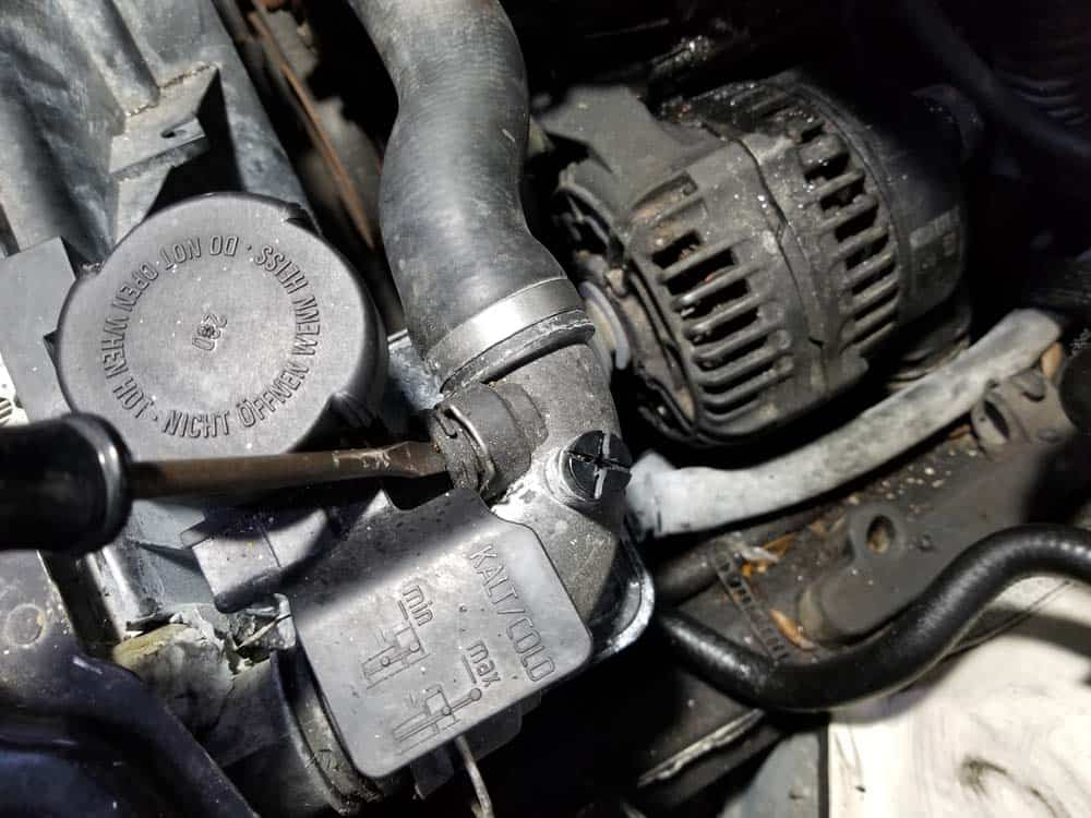bmw e46 alternator replacement - Use a flat blade screwdriver to gently pry the hose off of its fittings if it is stuck
