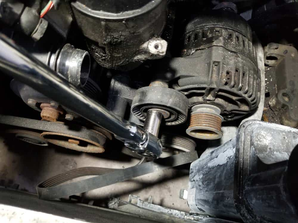 bmw e46 alternator replacement - Use a 16mm socket wrench to loosen the top mounting bolt
