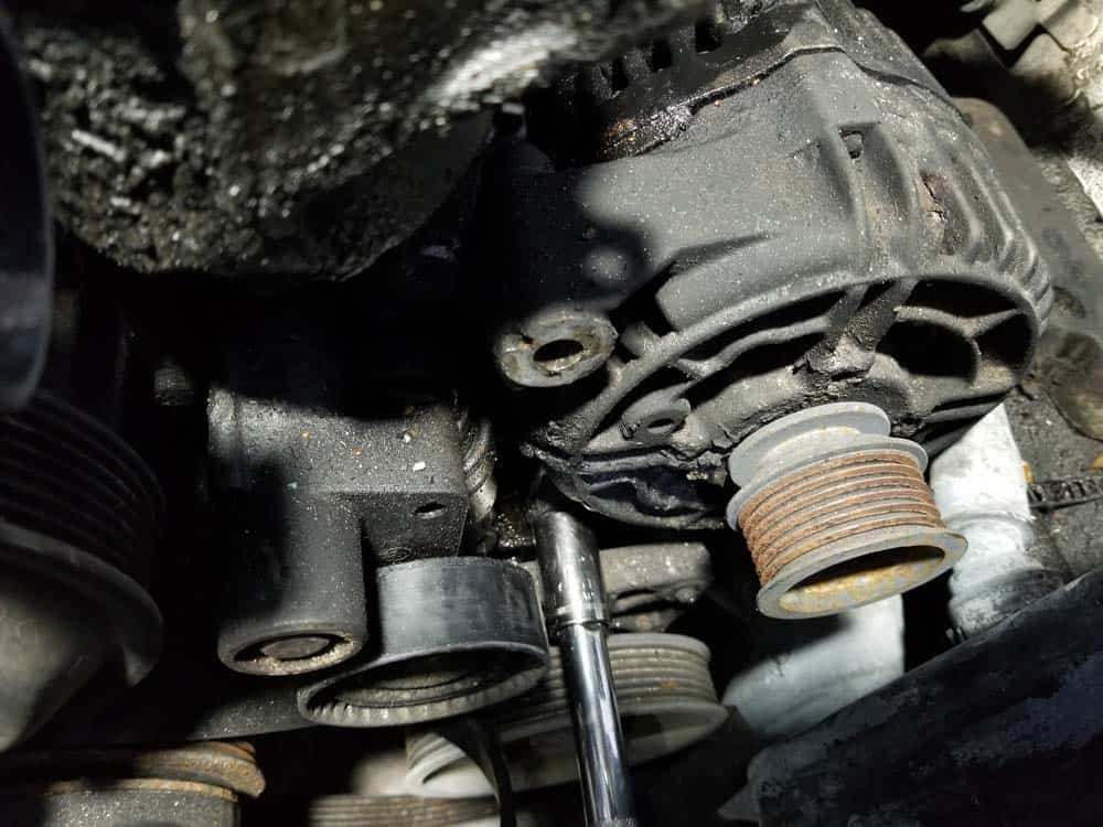 bmw e46 alternator replacement - Use a 16mm socket wrench to remove the lower mounting bolt