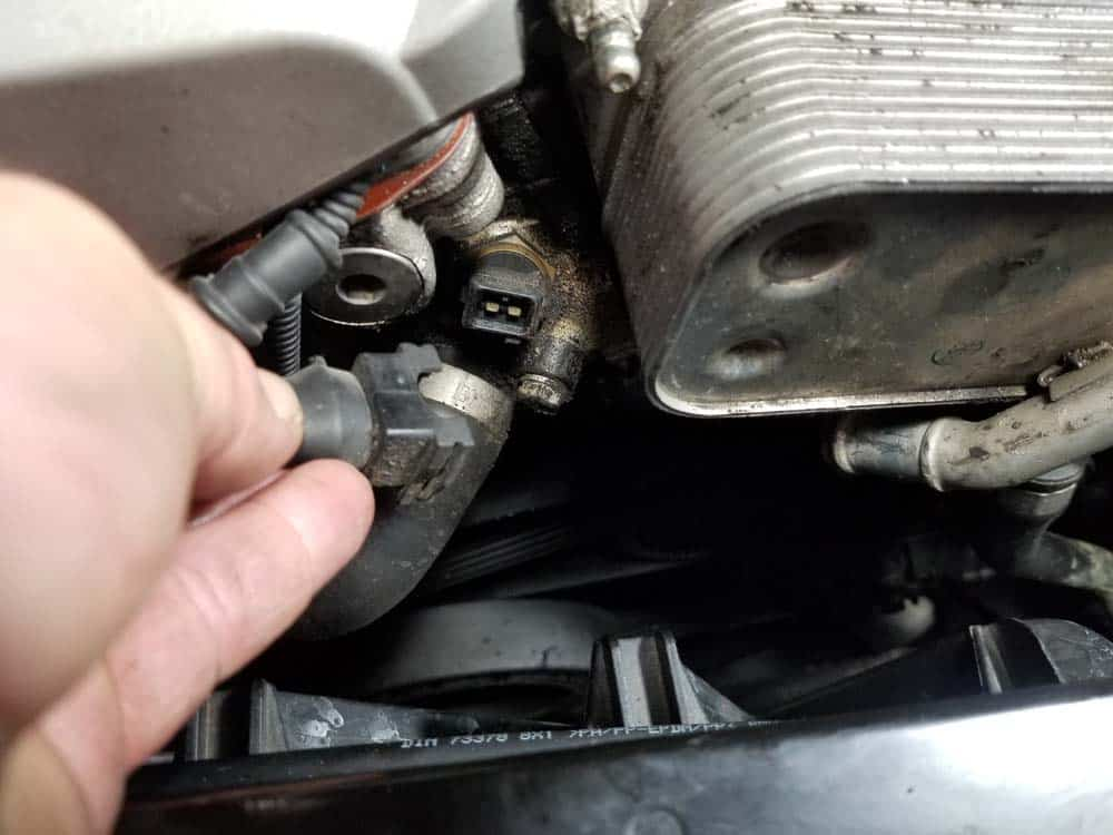bmw n52 oil filter housing gasket replacement - Unplug the cylinder head coolant temperature sensor.