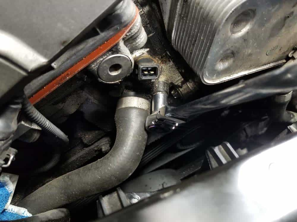 bmw n52 oil filter housing gasket replacement - Remove the two bolts anchoring the thermostat coolant line.