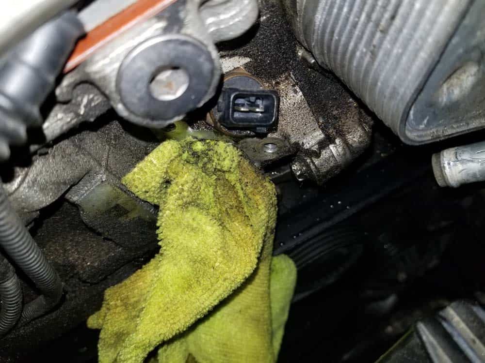 Stuff a rag in the cylinder head to keep the coolant from seeping out