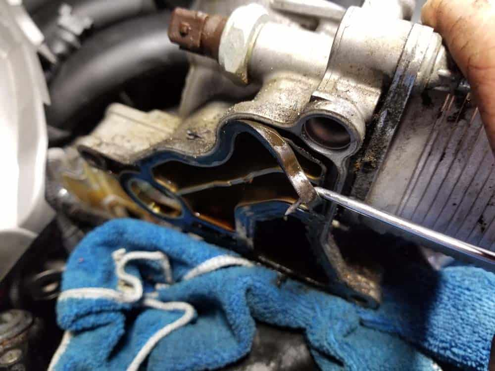 Use a metal pick to remove the old oil filter mount gasket
