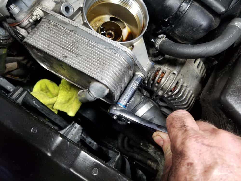 bmw n52 oil filter housing gasket replacement - Remove the three oil cooler mounting bolts