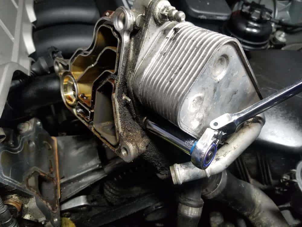 The lower oil cooler mounting bolt