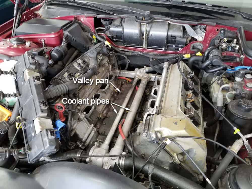 bmw m60 valley pan replacement - identify the valley pan located under the coolant pipes