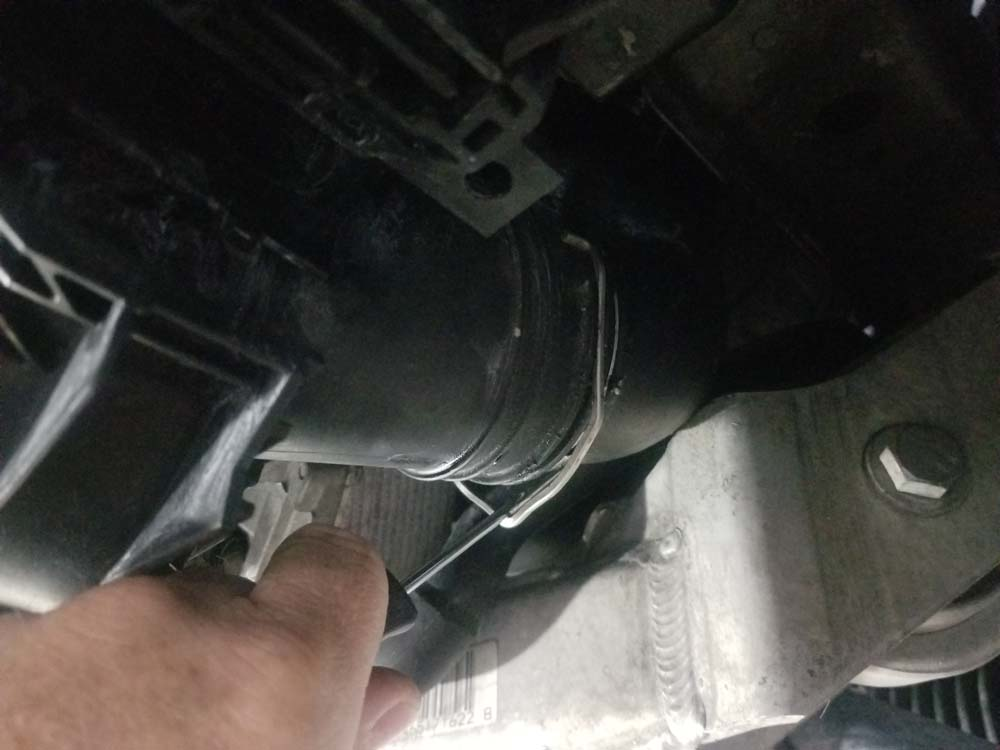 bmw e90 thermostat replacement - release the charge tube locking clips
