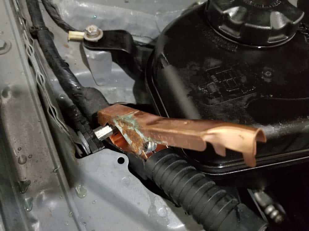 bmw e90 thermostat replacement - Attach the battery charger to the engine compartment terminals