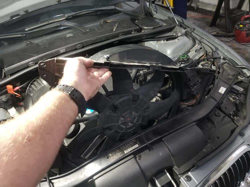 bmw e90 thermostat replacement - Remove the electric cooling fan from the vehicle