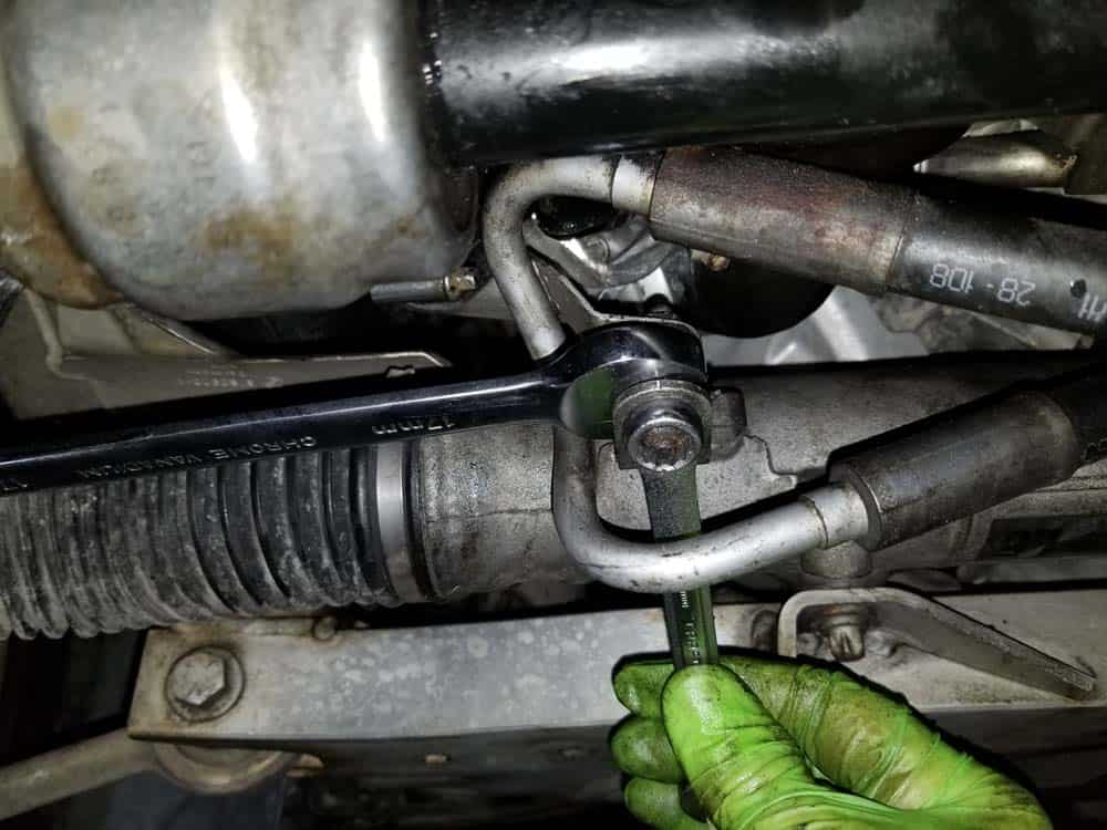 bmw e90 water pump replacement - Remove the power steering line.