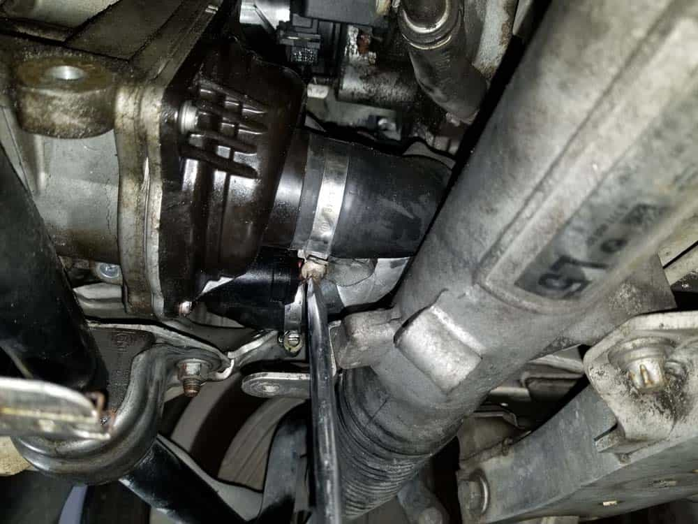 bmw e90 water pump replacement - Loosen the hose clamp on the thermostat coolant hose.