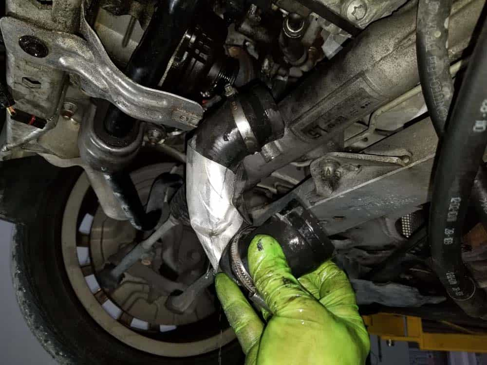 Remove the thermostat coolant hose from the pump.