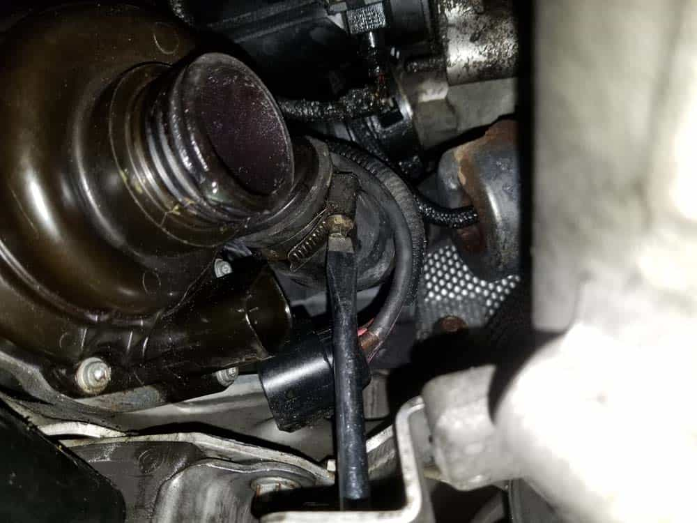 bmw e90 water pump replacement - Remove the engine block coolant line from the back of the pump