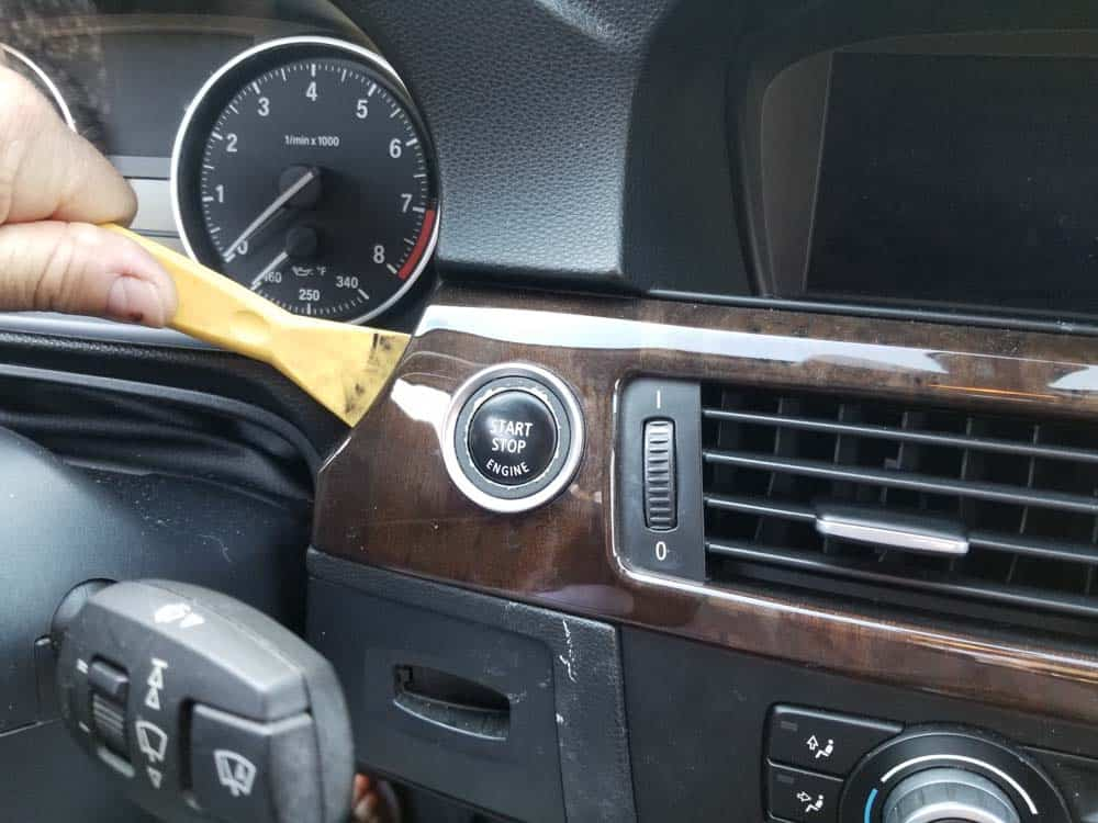 bmw e90 start button replacement - Use a plastic trim tool to loosen the dashboard trim