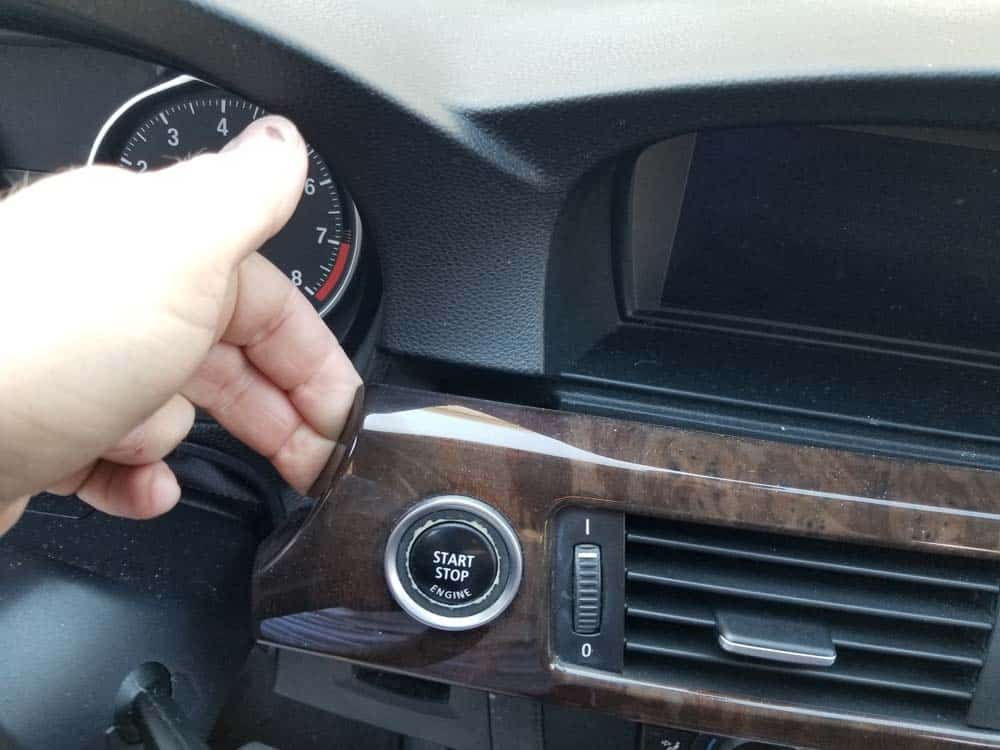 Use your fingers to pull the trim free from the dashboard.