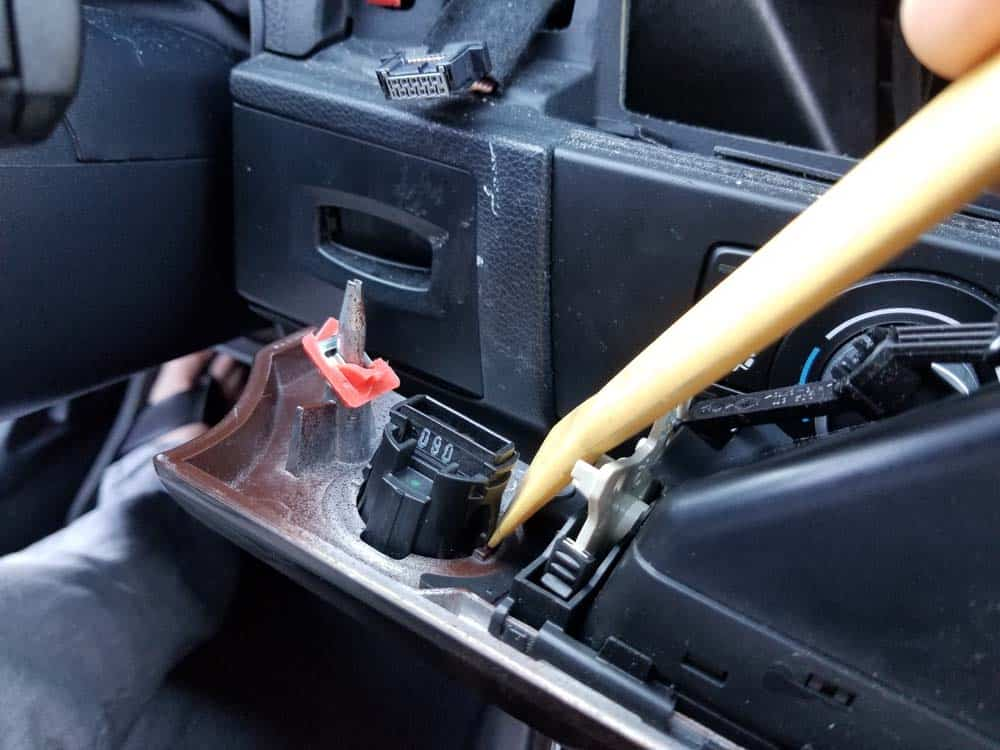 bmw e90 start button replacement - Depress the metal locking clips with a plastic trim tool