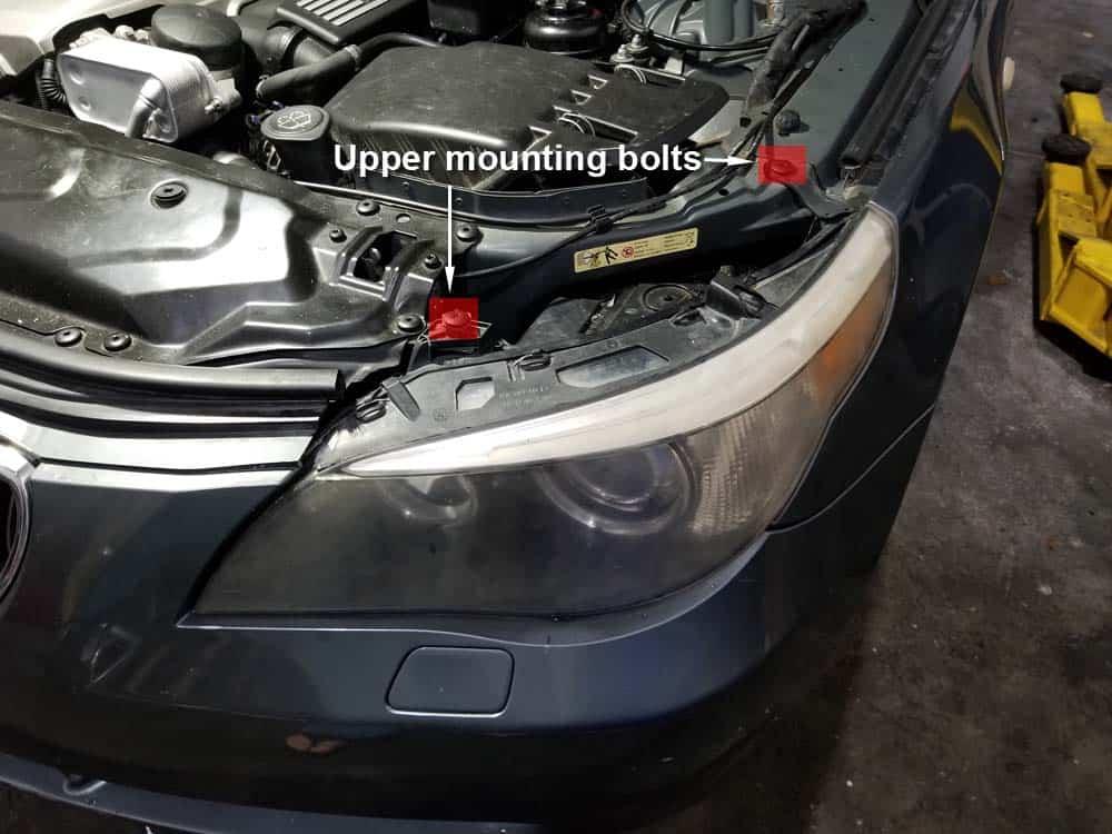 bmw e60 xenon headlight bulb - Locate the two upper mounting bolts
