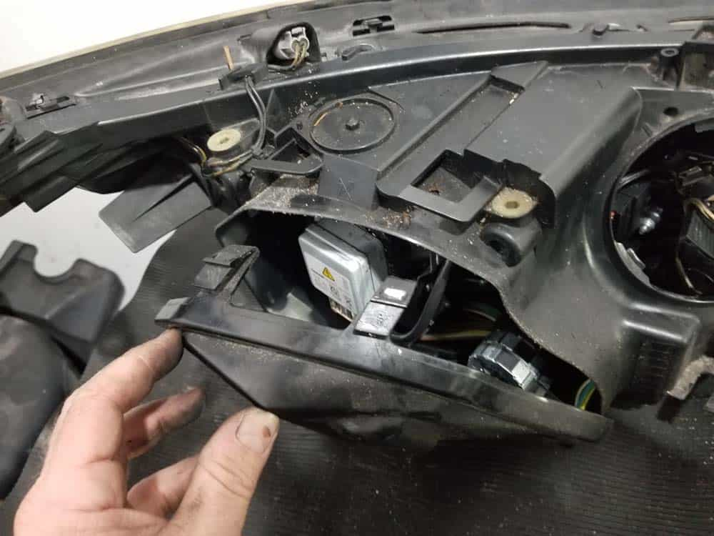 Pull the bulb cover free from the headlight