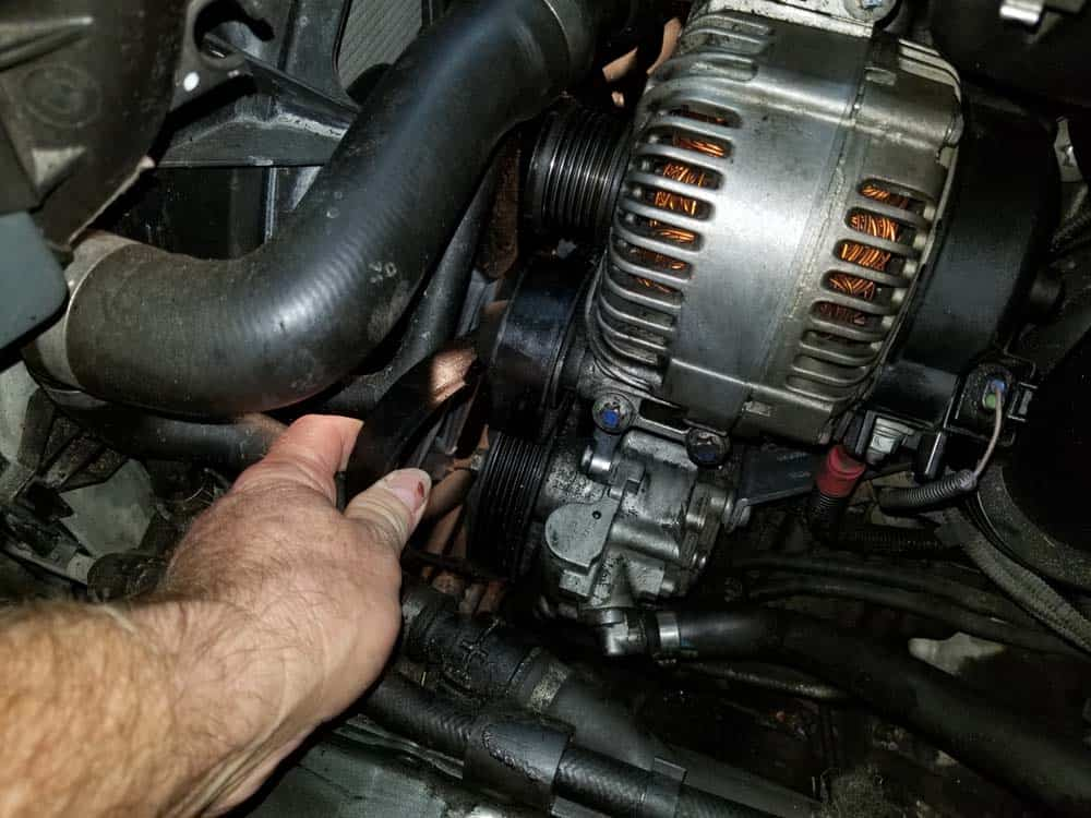 bmw e60 serpentine belt and pulley replacement - Remove the accessory belt from the alternator