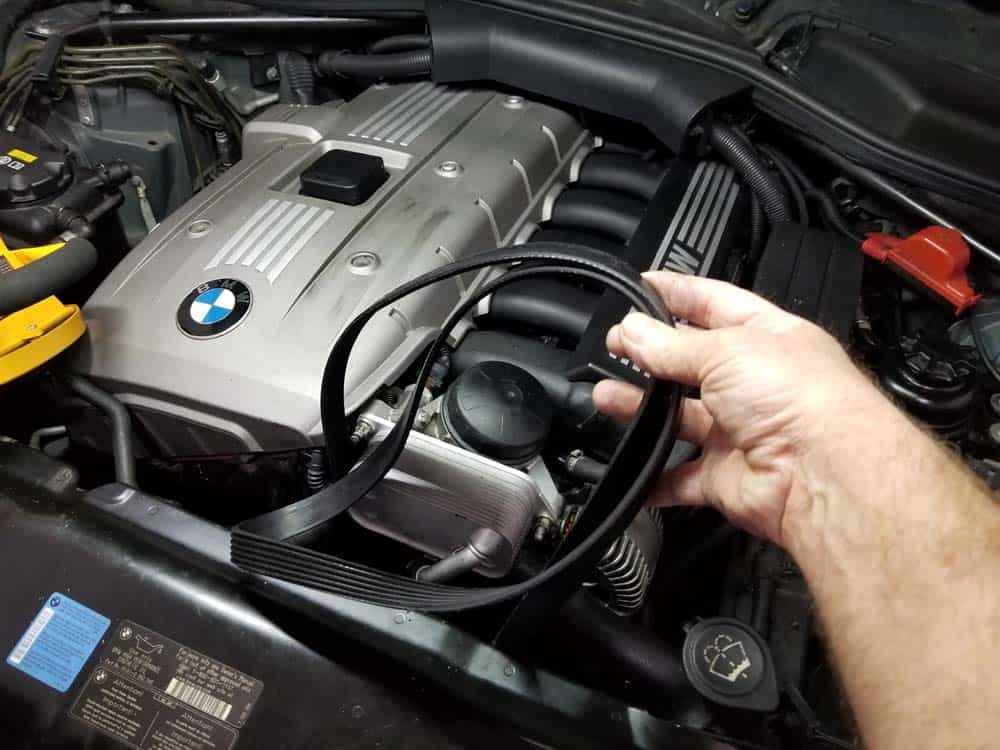 Remove the serpentine belt from the engine