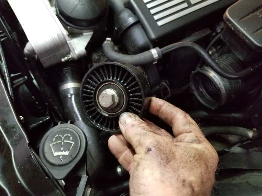 Remove the deflection pulley from the vehicle