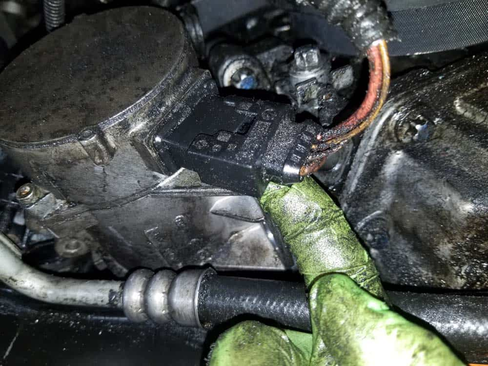 bmw e60 thermostat replacement - Depress the locking tab pn the back of the water pumps electrical connector
