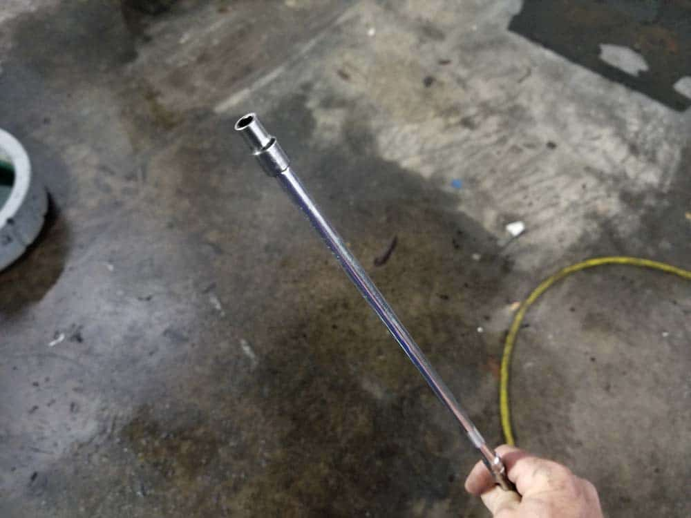 bmw e60 water pump replacement - Use a socket extension to loosen the hose clamp