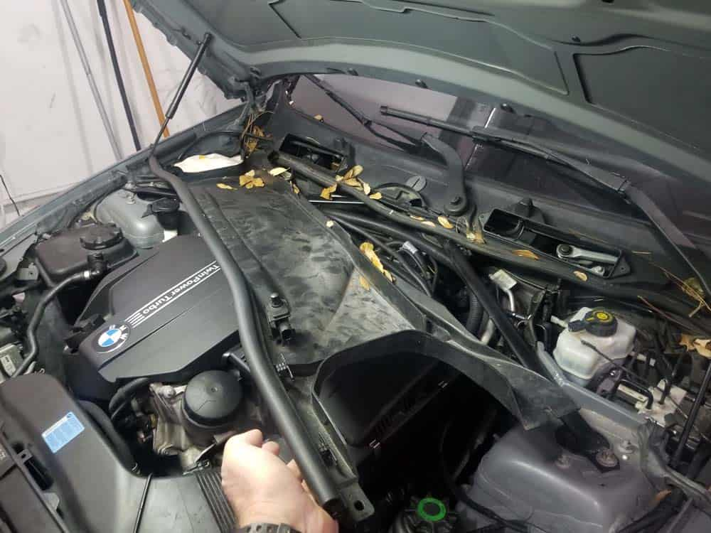 bmw n55 starter replacement - Remove the lower microfilter housing from the vehicle