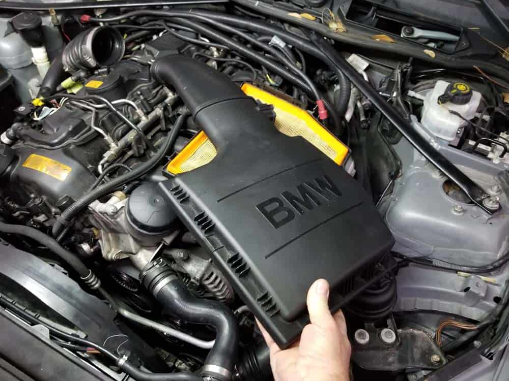 bmw n55 starter replacement - Remove the intake muffler cover from the vehicle