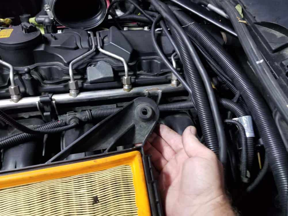 bmw n55 starter replacement - Remove the lower intake muffler from the engine