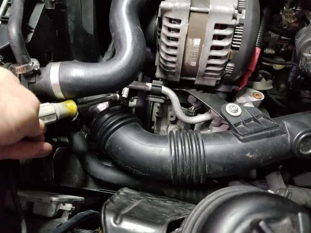 bmw n55 starter replacement - Loosen the hose clamp on the charge pipe