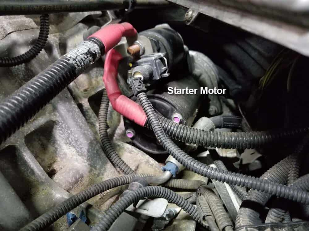 bmw n55 starter replacement - Identify the starter motor at the rear of the engine