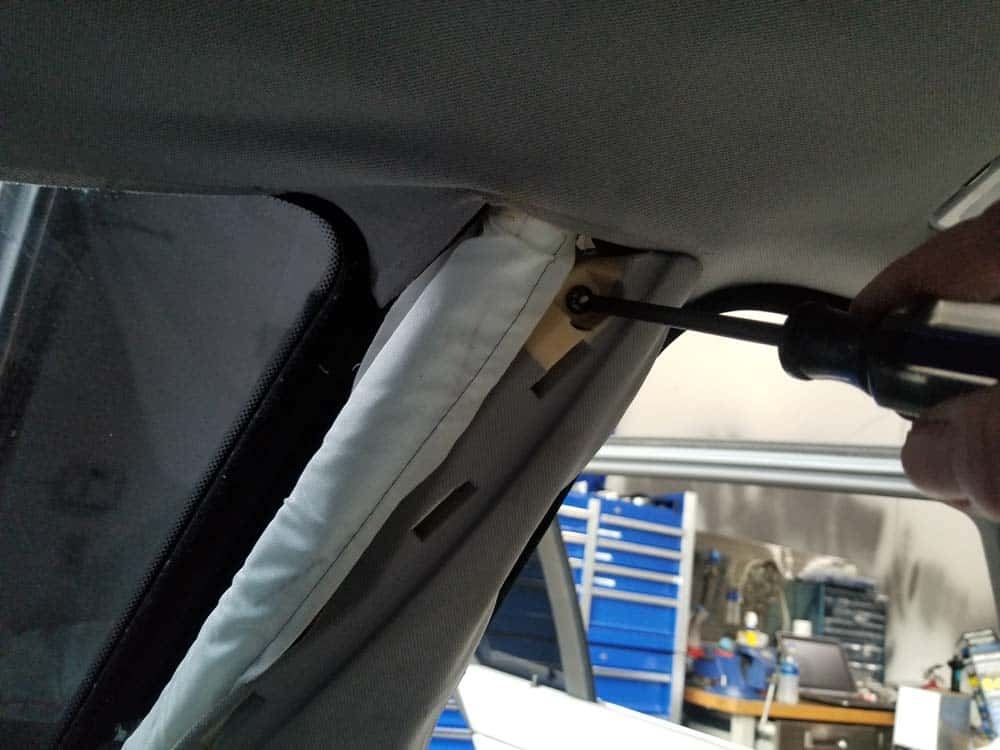 bmw e61 headliner removal - Remove the phillips screw securing the top of the C pillar trim